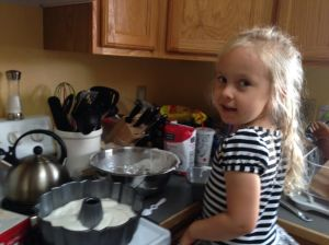 Mia helps bake cake May 2014