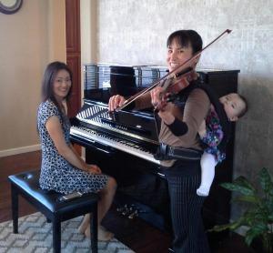 Nao plays violin